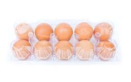 Eggs in a plastic carton Stock Photo