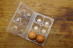 Eggs and plastic egg box Stock Images
