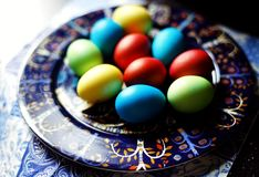 Eggs plate close-up multicolors light easter. Indoor table food Royalty Free Stock Photography