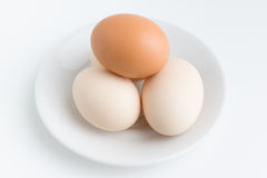 Eggs on plate Stock Photos