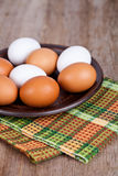 Eggs in a plate and towel Royalty Free Stock Photo