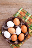 Eggs in a plate, towel and feathers Royalty Free Stock Photo