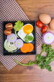 Eggs poached with vegetables Stock Image