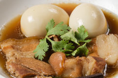 Eggs and pork in brown sauce stock images