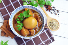 eggs and pork in brown sauce. three layer pork with eggs in sweet gravy sauce. braised pork belly and chicken eggs in soy sauce wi Stock Photo