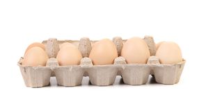 Eggs in protective case foreground Stock Photo