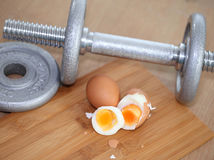 Eggs protein diets and dumbbells Stock Photo