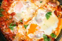 Eggs in purgatory or shakshouka close up Royalty Free Stock Image