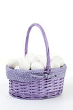 Eggs in Purple Wicker Basket Isolated on White  Royalty Free Stock Photography