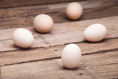 The eggs put on a small group. On a wooden table from old boards Stock Photos
