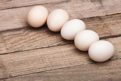The eggs put on a small group. On a wooden table from old boards Royalty Free Stock Photography