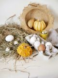 Eggs and quail eggs in a package, pumpkins , hay, Easter concept, preparation for the holiday, harvest, seasonal holidays. Village, farm, subsistence farming stock photo