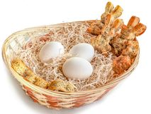 Eggs and rabbit-shaped cookies in a basket for Easter stock images