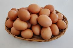 Eggs in rattan basket. Royalty Free Stock Photography
