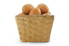 Eggs in rattan basket. On white background isolate Stock Images