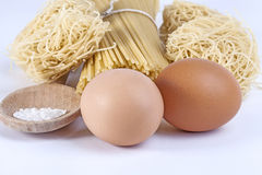 Eggs and raw pasta isolated Stock Image