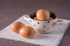 Eggs raw in a saucepan stock photography