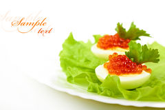 Eggs with red caviar Stock Photography