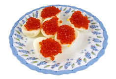 Eggs with red caviar Stock Photos