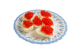 Eggs with red caviar Royalty Free Stock Photo