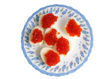 Eggs with red caviar Royalty Free Stock Images