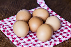Eggs on a  red dish towel Stock Photos