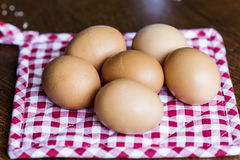 Eggs on a  red dish towel Stock Image
