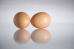 Eggs and reflection. Eggs on glossy table with reflection Stock Photo