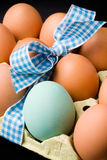Eggs with ribbon Royalty Free Stock Photos