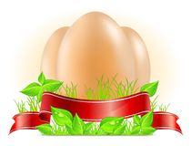 Eggs with ribbon on grass Royalty Free Stock Photo