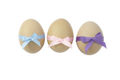 Eggs with ribbon. Eggs with pink ,purple and blue ribbon bow Stock Images