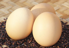 Eggs. On rice berry and bamboo Stock Photo