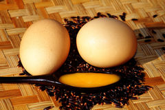 Eggs on rice berry. And bamboo tray Royalty Free Stock Images