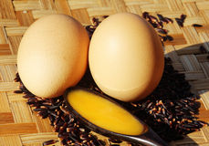 Eggs on rice berry. And bamboo tray Royalty Free Stock Photo