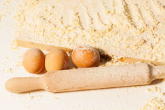 Eggs and rolling pin stained with flour Royalty Free Stock Image