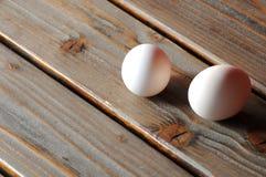 Eggs on a rough table Stock Photos