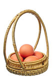 Eggs in a round basket Royalty Free Stock Photos