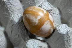 Eggs rounded forms. Are painted in the cells of the pressed paper royalty free stock images