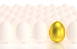 Eggs in a row one gold egg Royalty Free Stock Images