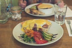 Eggs royale with salmon in cafe Royalty Free Stock Photo