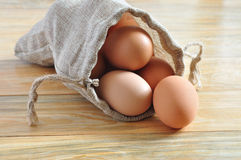 Eggs in a Sack on Top of Rustic Wood Stock Photos