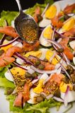Eggs salad with salmon and capers Royalty Free Stock Images