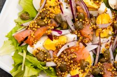 Eggs salad with salmon and capers Royalty Free Stock Photo