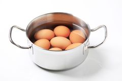 Eggs in a saucepan Stock Photo
