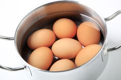 Eggs in a saucepan Royalty Free Stock Photos