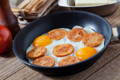 Eggs and sausage Stock Images