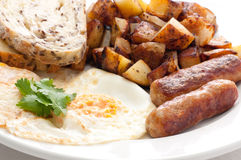 Eggs, sausage and home fries breakfast Royalty Free Stock Images