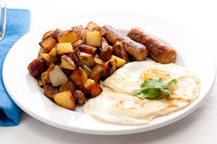 Eggs, sausage and home fries breakfast Royalty Free Stock Photos