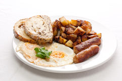 eggs, sausage and home fries breakfast Royalty Free Stock Photography