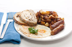 eggs, sausage and home fries breakfast Stock Images